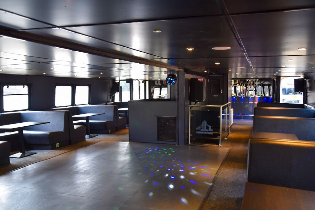 Enjoy party hits from the DJ on the NYE Thames cruise